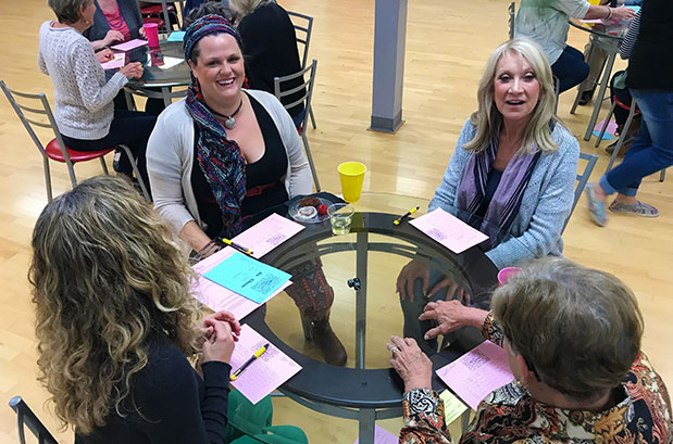 Ladies at table playing bunco