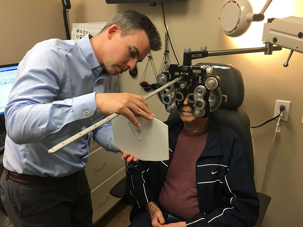Optometrist with low vision patient
